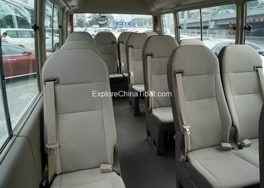 Tibet Car Rental Toyota Coaster-Rearing Seats 1