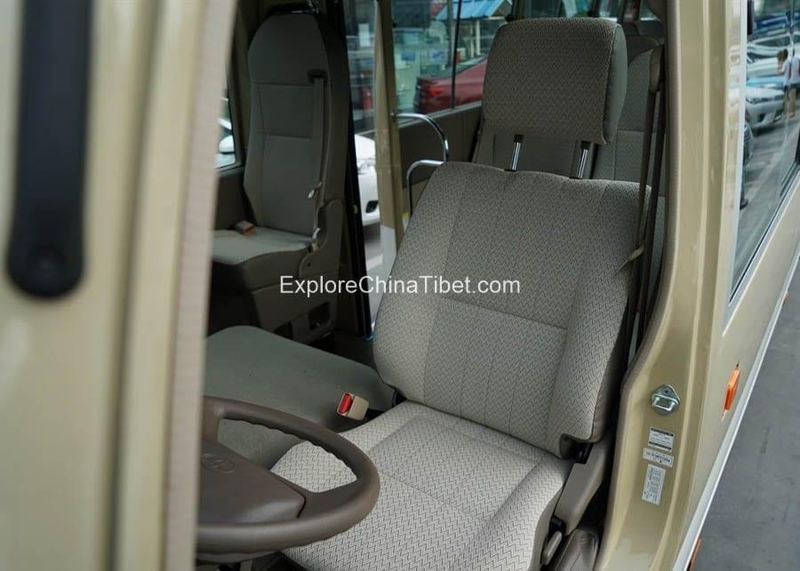Tibet Car Rental Toyota Coaster- Rearing Seats 2