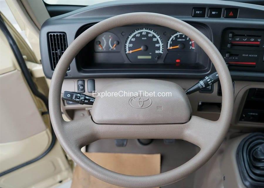 Tibet Car Rental Toyota Coaster-Steering Wheel 1