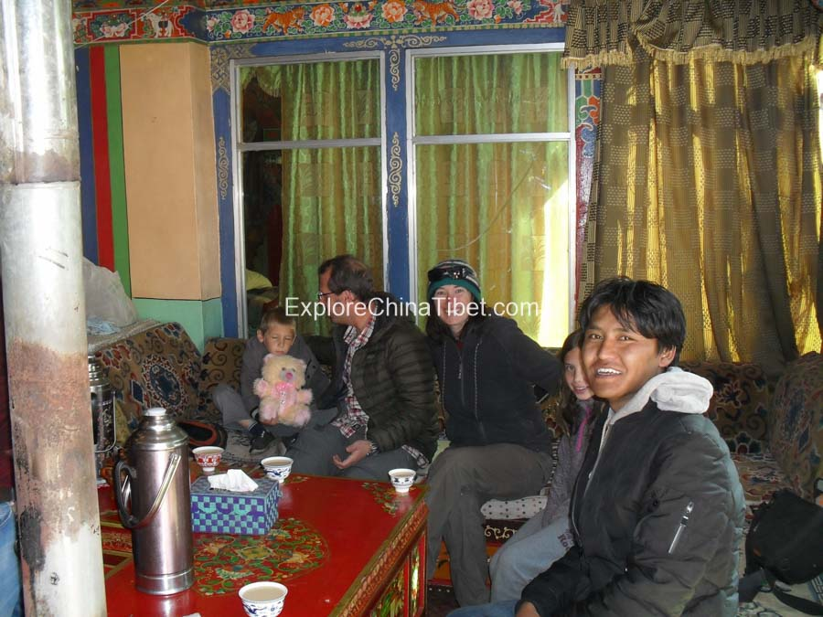 Tibetan guide with our clients to Tibetan family