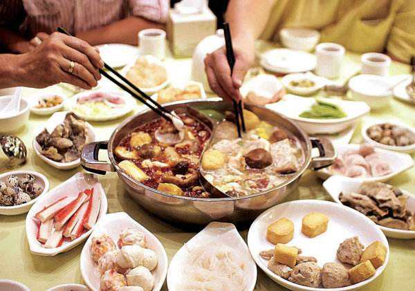 social gathering eating hot pot